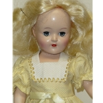 Toni pale blonde in pale yellow dress